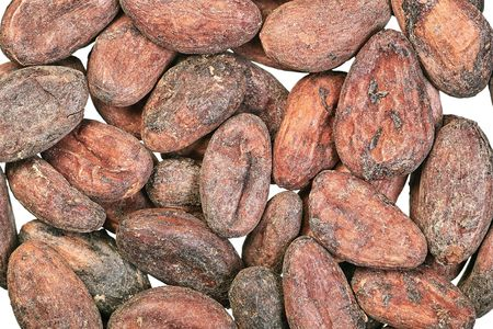 Cocoa beans close-up on white background Stock Photo