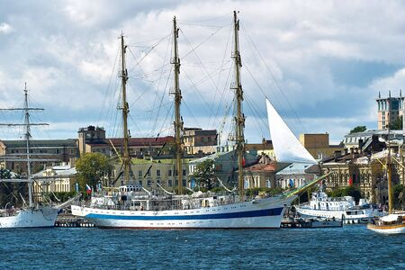 Big white tallships moored near the quay in front of old buildings. Stock Photo - 5537431
