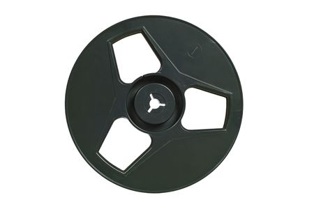 Old-fashioned tape recorder spool. Isolated image on white background photo