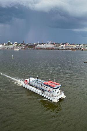 Small passage-catamaran in Helsinki harbor