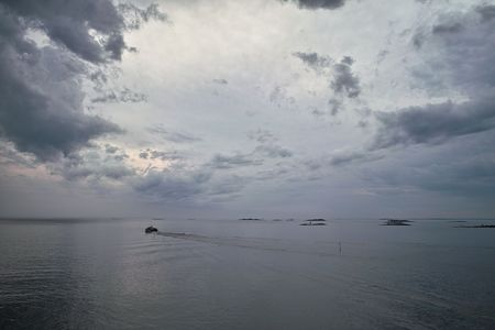 Cloudy evening in open sea