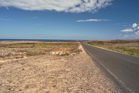 Asphalt road through the wilderness to ocean Stock Photo - 9688216
