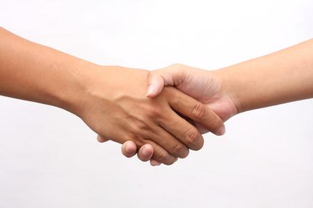 stretta di mano: Riuscito handshaking uomo e donna su sfondo bianco