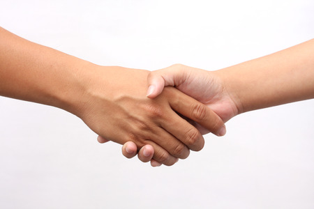 men shaking hands: Successful man and woman handshaking on white background
