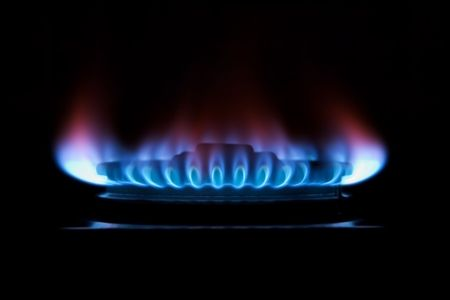 flame of a gas ring in the darkness photo