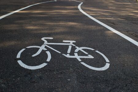 tarmac bicycle path with painted sign Stock Photo