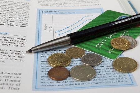 accounts payable: credit card, coins, pen and the economy textbook
