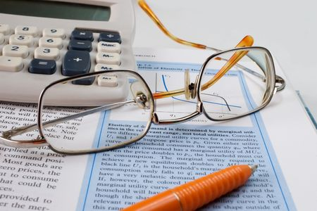glasses, calculator and textbook