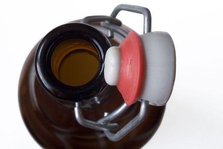 opened bottle with old-fashioned stopper photo