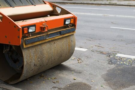 fragment of steamroller on tarmac road