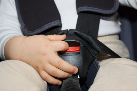hand on carseat safety harness