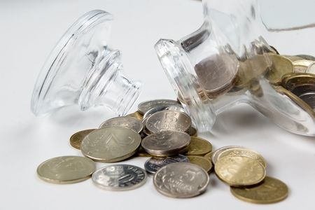 coins  and glass bottle  on the white photo