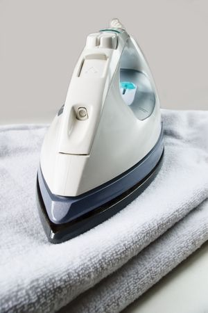 electric iron on towel Stock Photo