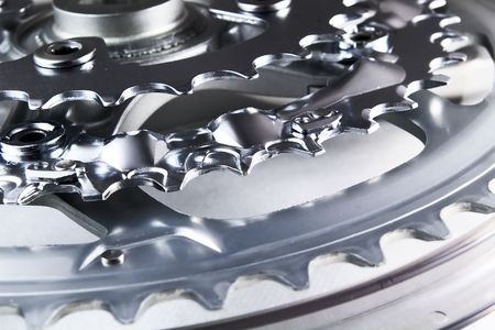 front bicycle chainrings set on white background photo