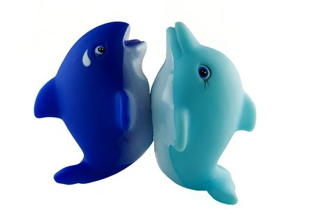 squeaky clean: bath toys, blue orca and turquoise dolfin on tails