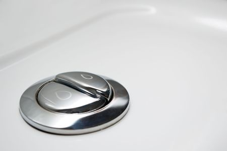 flushing: economic toilet flush knob with two separate buttons Stock Photo