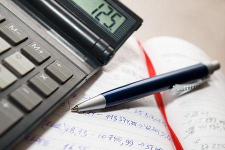 calculator  and the pen on the  handwritten agenda book Stock Photo - 966532