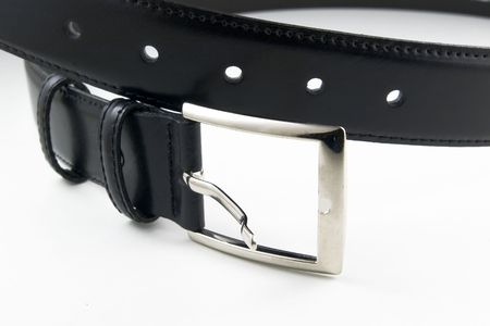 black leather belt with buckle unfastened on white background photo