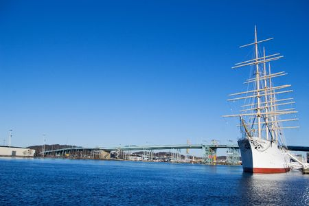 big sail ship moored in the Gothenburg harbour under clear blue skies photo