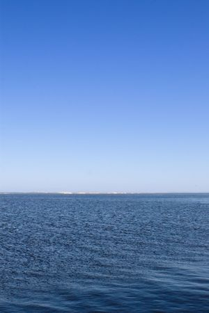 horizon over water: horizon over water on bright summer day  (portrait orientation) Stock Photo