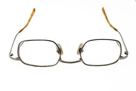 angled view: pair of spectacles on white background Stock Photo