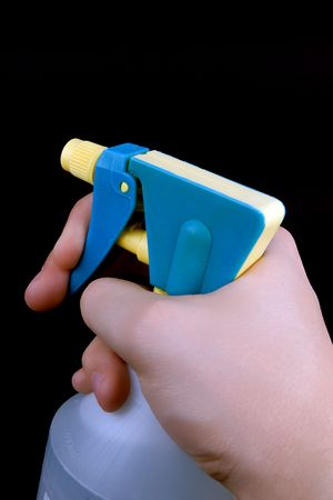tetik: hand pressing the trigger of household sprayer