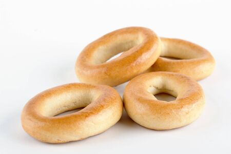 rubicund: heap of small bagels on white background