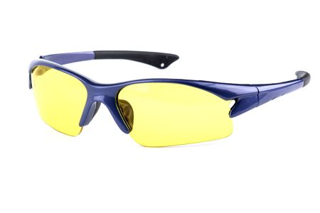 sport glasses with yellow interchangeable lens isolated on white photo