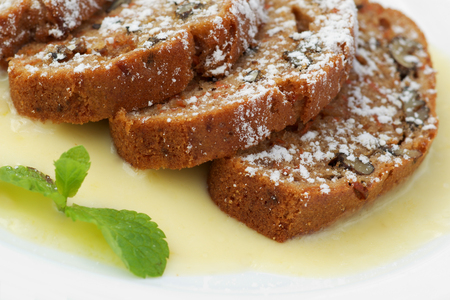 hot carrot cake with vanilla sauce and mint leaf Stock Photo