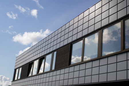 glass block: modern office building under the skies Stock Photo