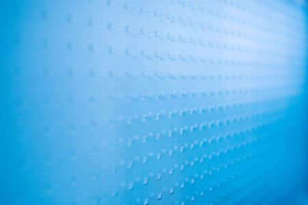 diagonals: abstract textured blue glass background with diminishing perspective
