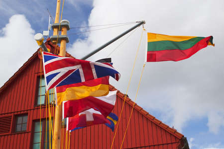 Lithuanian flag with some other european flags near the Klaipeda yacht harbour photo