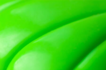 abstract smooth bright green plastic background photo