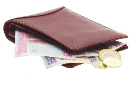 bulging: brown leather wallet with banknotes and coils bulging out Stock Photo