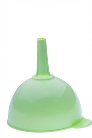 green plastic kitchen funnel on white photo