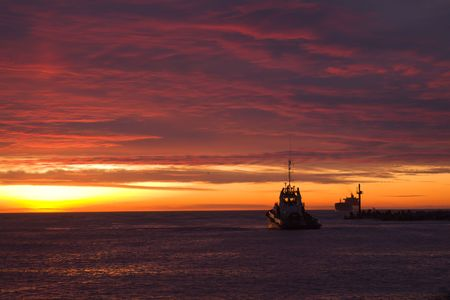 tuboat waiting for vessel calling to port on sunset Stock Photo - 2639689