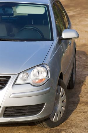 unpaved road: modern car on the unpaved road Stock Photo