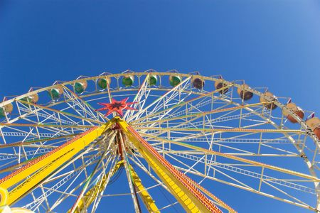 observation wheel: observation wheel from below  under blue sky Stock Photo