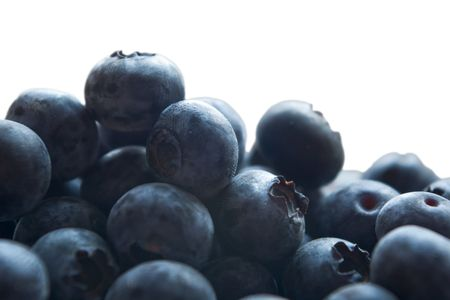 backlite: heap of blueberries on white in backlite Stock Photo