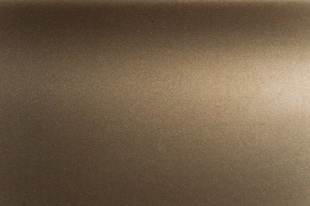 texture of a metal painted with bronze enamel Stock Photo