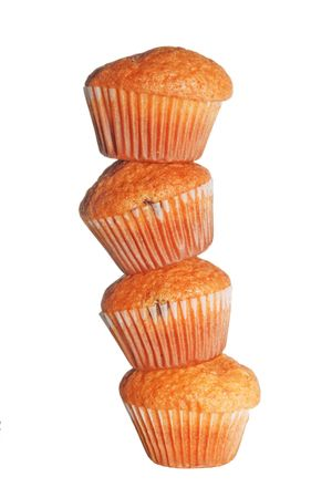 dainty: heap of four muffins isolated on white