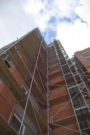 residential building with scaffoldings from below photo