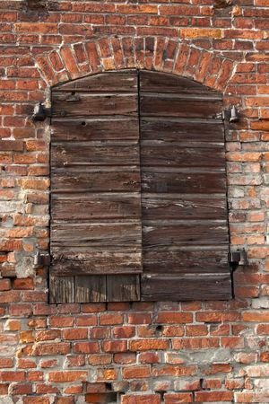 vaulted door: closed cargo door of old  brick warehouse