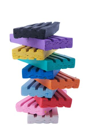stacked bars of modelling clay on white Stock Photo
