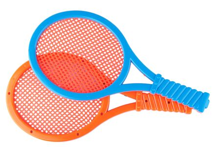 pair of plastic toy rackets