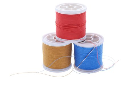 three plastic reels with sewing thread photo