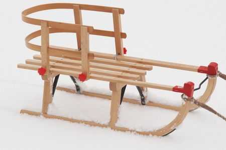 wooden child  sledge  on the snow photo
