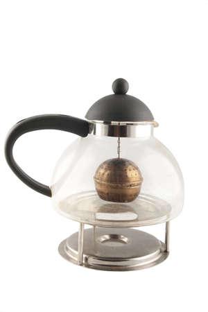 trivet: old used glass teapot on stainless steel trivet