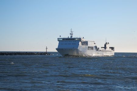 ferry vessel entering port on sunny day Stock Photo