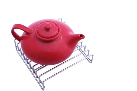 red oriental style teapot on the grill isolated on white Stock Photo - 5732974
